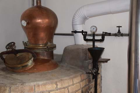 The copper hood and the pressure gauge