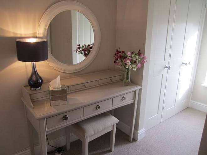 Dressing Area with floor to ceiling wardrobes