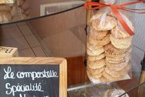 House made marzipan biscuits in cellophane bags in shop window in France