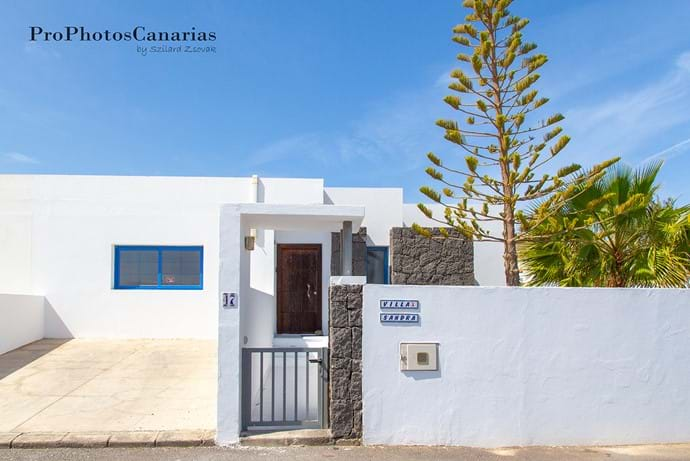 Front of the house with private parking space.