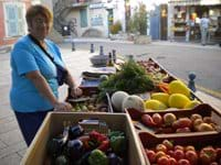 Madame Aicard selling her vegetables in Ampus main square