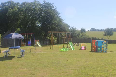 The play area in the paddock next to the house