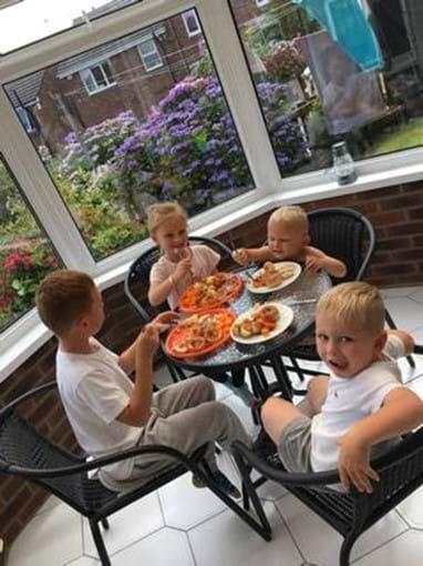 Kids enjoying Sunday dinner