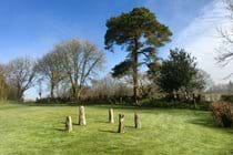 The stone circle, and view of the garden, looking towards our top gate.