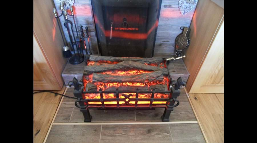 Vintage electric fire, kept in the cupboard next to the logburner for guests who prefer to use it