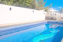 large private pool area with sofa and shade to watch the children play