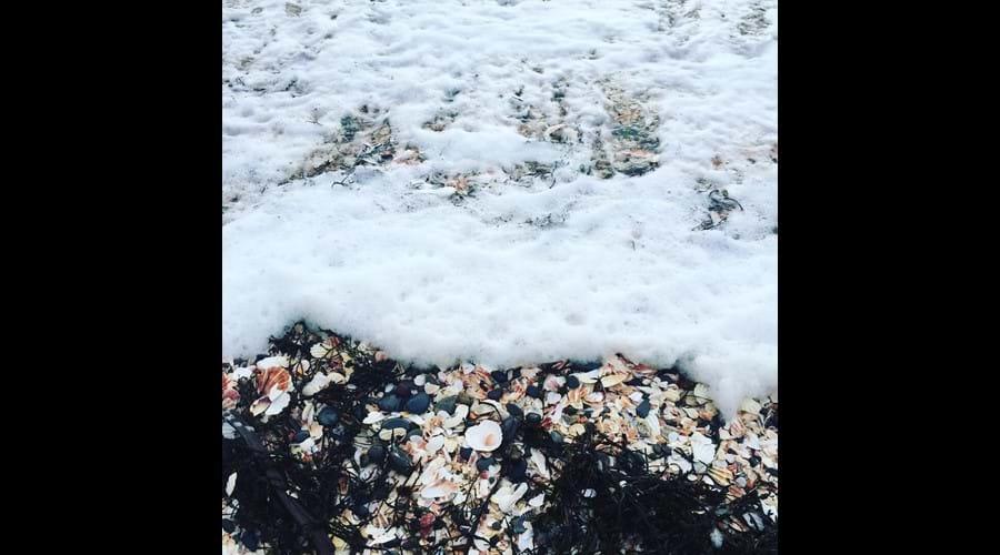 Foaming sea at Fenella beach, Peel