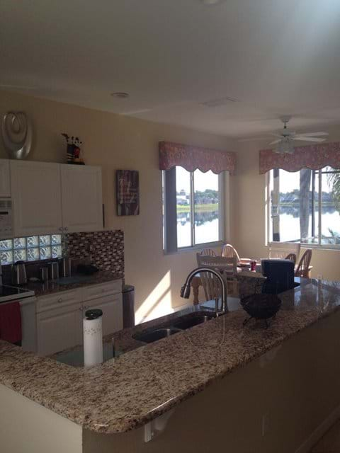Large fully equipped family kitchen opens out onto dining table and family room