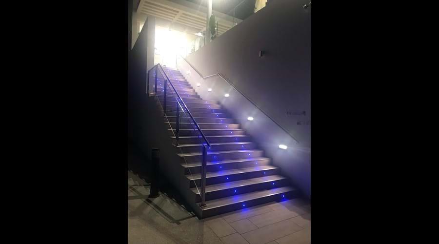 Lights lead the way to the upstairs of La Antigua Bar