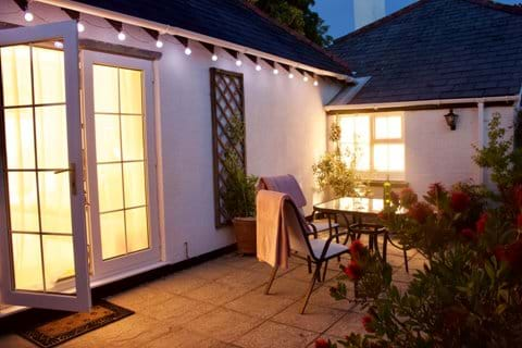 New Forest self catering accommodation terrace at night.