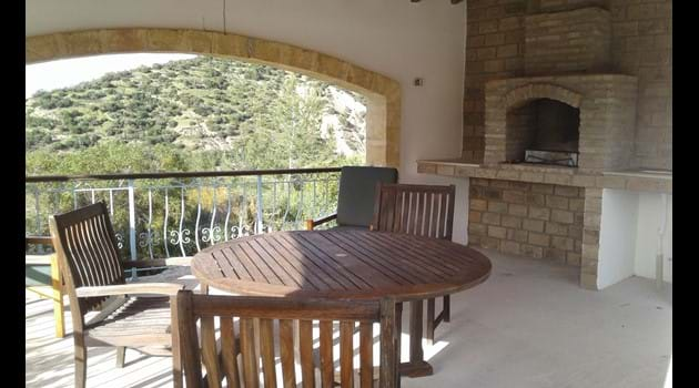 Covered pergola area with built in BBQ