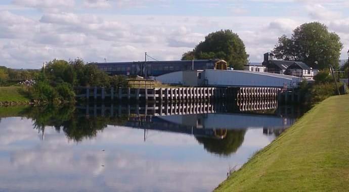 Caledonian canal swing bridge and train