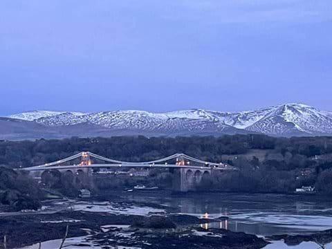 Wonderful mountain vista with Menai Bridge and the Straights in four ground