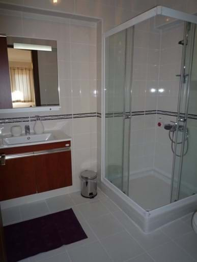 One of four bathrooms (3 x en-suite, 1 shared on the ground floor)