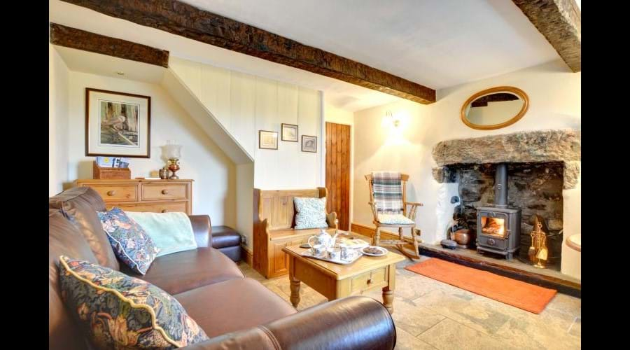 ...and step into your home for a while. Enjoy the charm of traditional beams, inglenook fireplace, tiled floors and cottage doors...