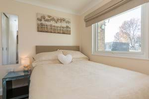 Comfortable double master bedroom with fitted double wardrobe, full length mirrror and stylish glass side table