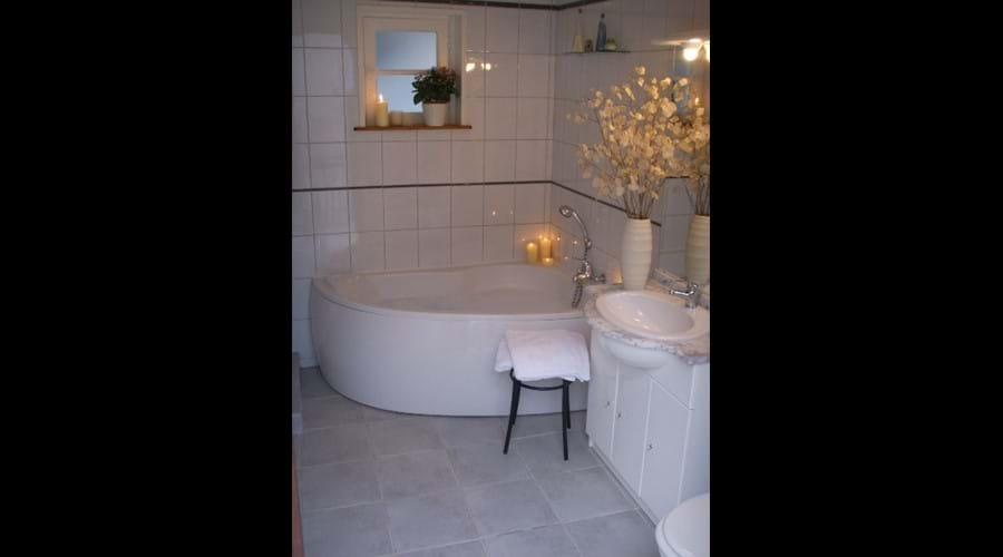 Bathroom with bath...