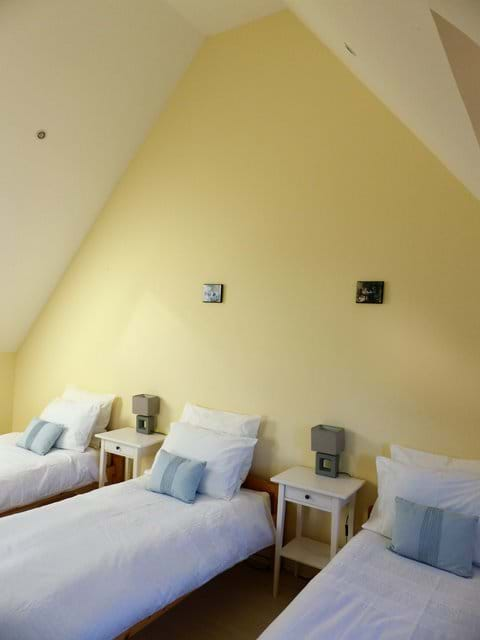 Triple room with vaulted ceiling