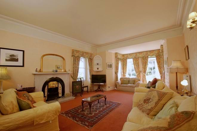 photo showing spacious sitting room at Eisteddfa holiday cottage for 10 Criccieth
