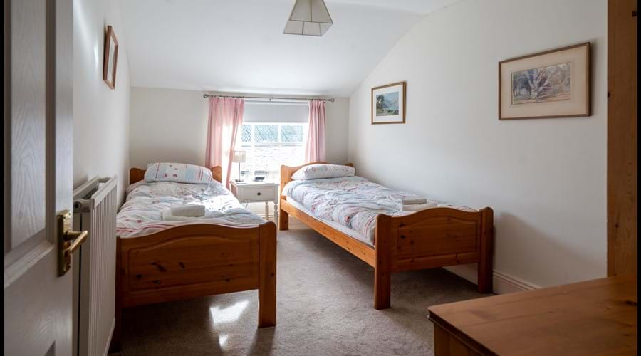 2nd Floor Twin Room with chest of drawers and wardrobe
