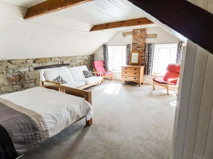 The master bedroom is huge, light and airy, with a lovely view across to the medieval Pele Tower opposite