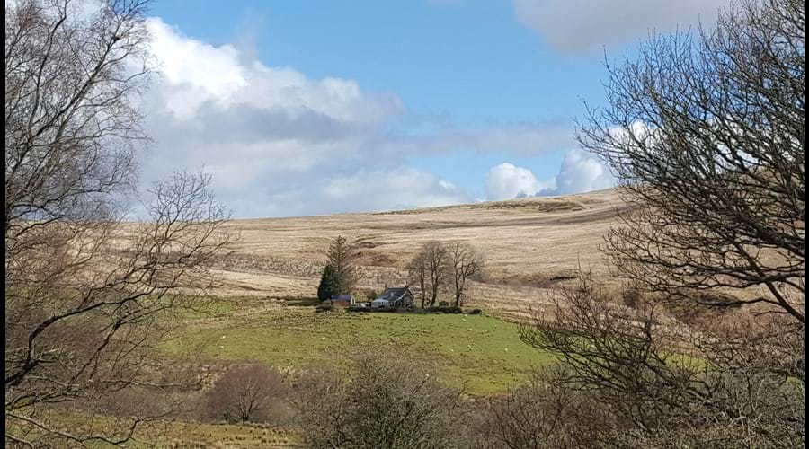 The back of the cottage from the hills
