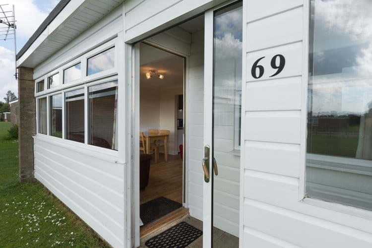 Front of chalet with enclosed porch area