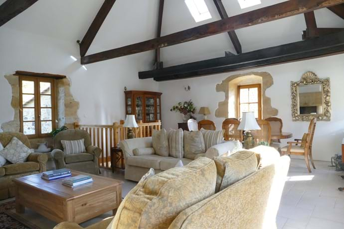 In the sitting room there is a lovely large dining table which can seat 8/10