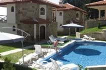 sun loungers, pool & jacuzzi at our group friendly chalet accommodation