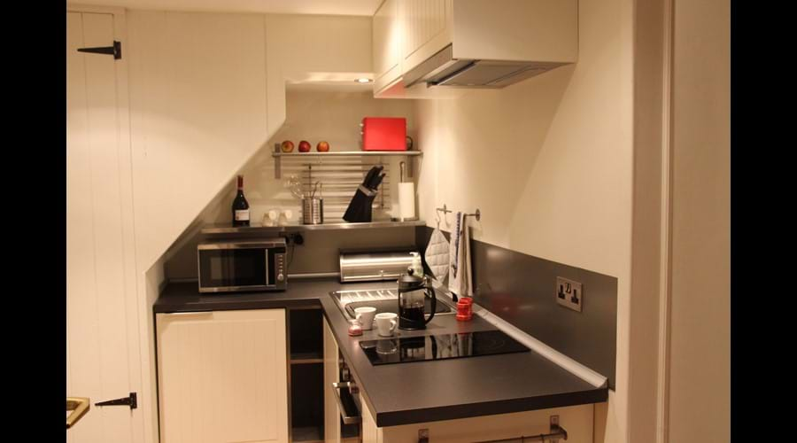 A compact but well equipped, stylish kitchen.