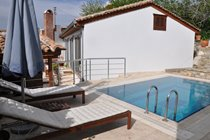 Pool terrace with sun loungers and umbrella