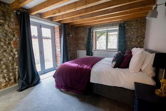 Master bedroom with doors to garden