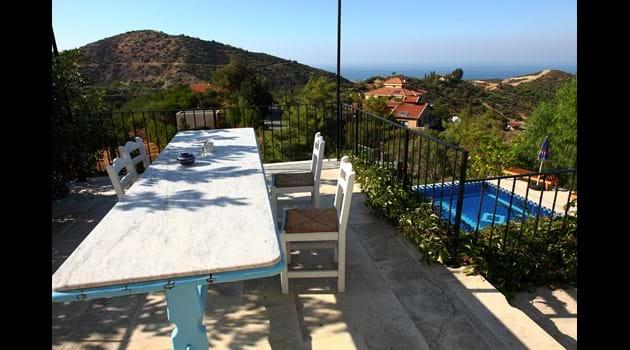 Kitchen terrace overlooking the pool.