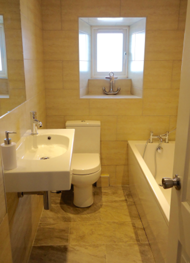There are two bathrooms. The downstairs bathroom has a bath.
