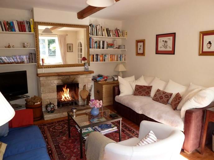 Drawing room is cosy with log fire (photo before recent redecoration)