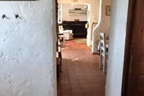 Looking through from the kitchen past the dining room to the sitting room in the house