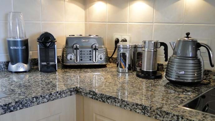 Gadgets in the kitchen include a Nespresso coffee machine, NutriBullet juicer, kettle and toaster