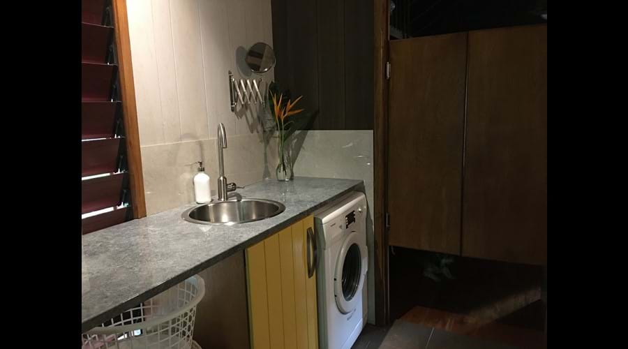 Laundry/wet room with 5kg front load washing machine & a line outside the back door for your convenience.