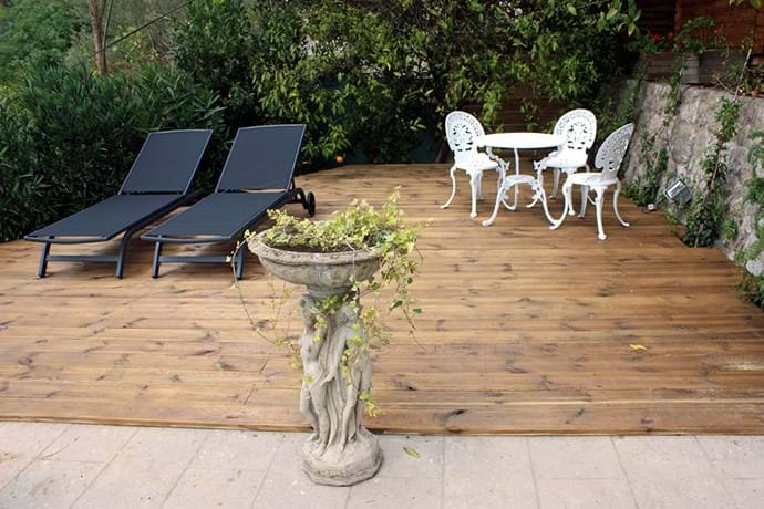 April 2015 - New Decking Terrace to the West of the Pool has added 40 sq. metres (430 sq.ft) of decking terrace by removing the old pine tree.   Sorry to see it go, but this is much more practical.