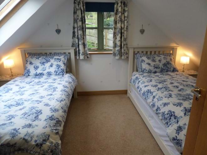 Triple Bedroom 2 with Two Single Beds and 1 Guest Bed
