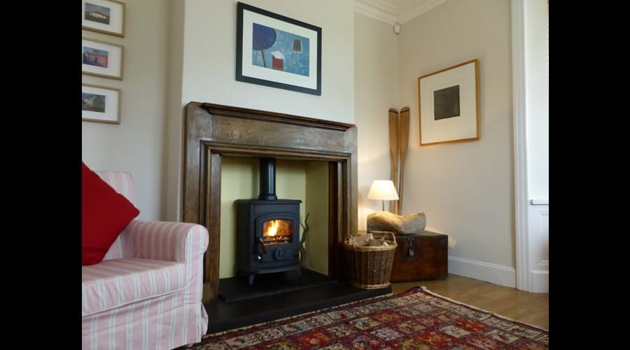 Cosy up by our wood burning stove in the lounge