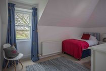 The red twin room is snug and cosy and has wonderful views of Wester Balgedie and the Ochil Hills beyond