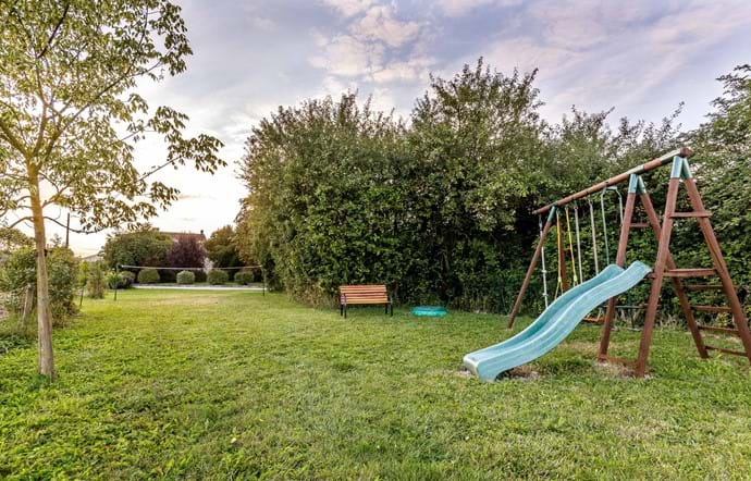 Children's swings/slide and grassed badminton court