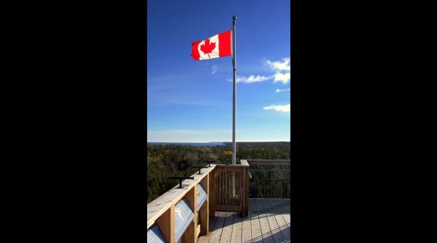The Canadian flag flies proudly a top the observation tower at the National Park visitor
