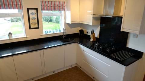 Newly fitted white gloss kitchen