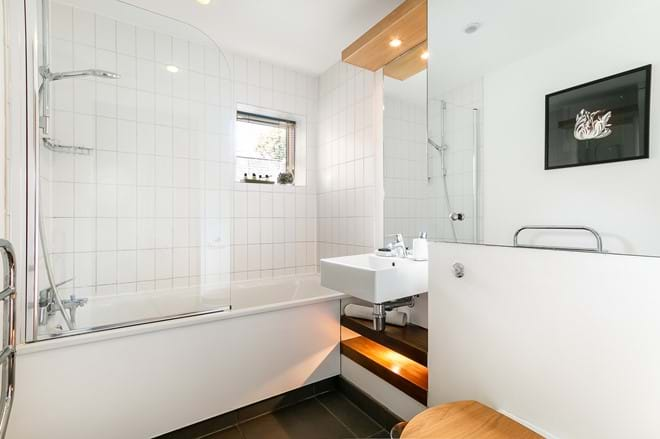 En suite bathroom has heated towel rail, underfloor heating, power shower over bath and plump, soft towels.