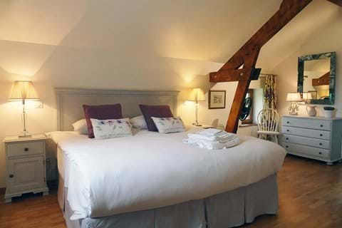 Bedroom 2 on the first floor is open to the rafters and has a super king sized bed which can be twin beds