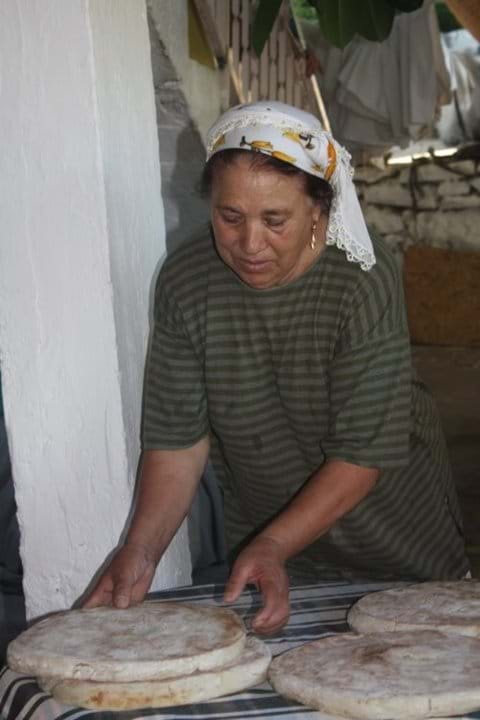 Local village lady baking bread