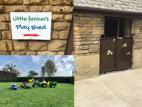 Children's play shed at Moo Cow Cottage, Ride on tractors all sizes available.