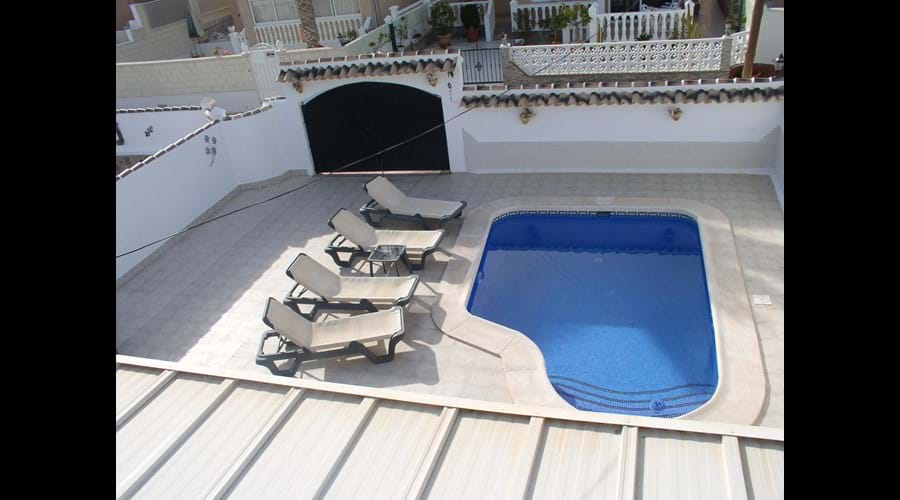 View of pool and garden from roof Solarium